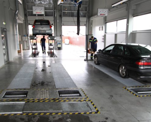 BM4010 test line in workshop with roller brake tester and suspension tester