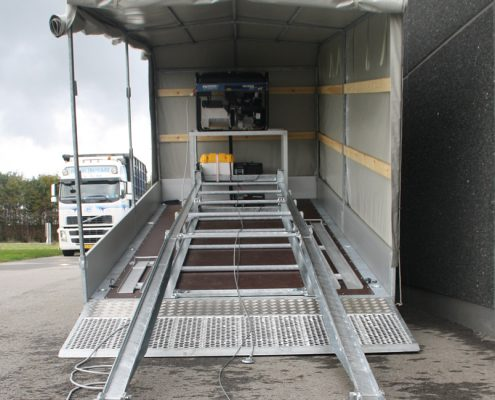 Rails are then moved to the top of the transport rail system whereafter the BM20200 mobile brake tester is rolled down using the electrical winch