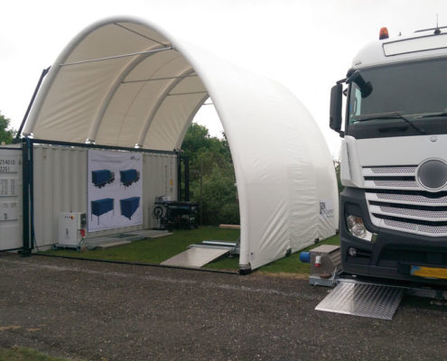 Inflatable pavilion on container with truck