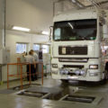 BM12200 roller brake tester installed over pit in workshop with truck