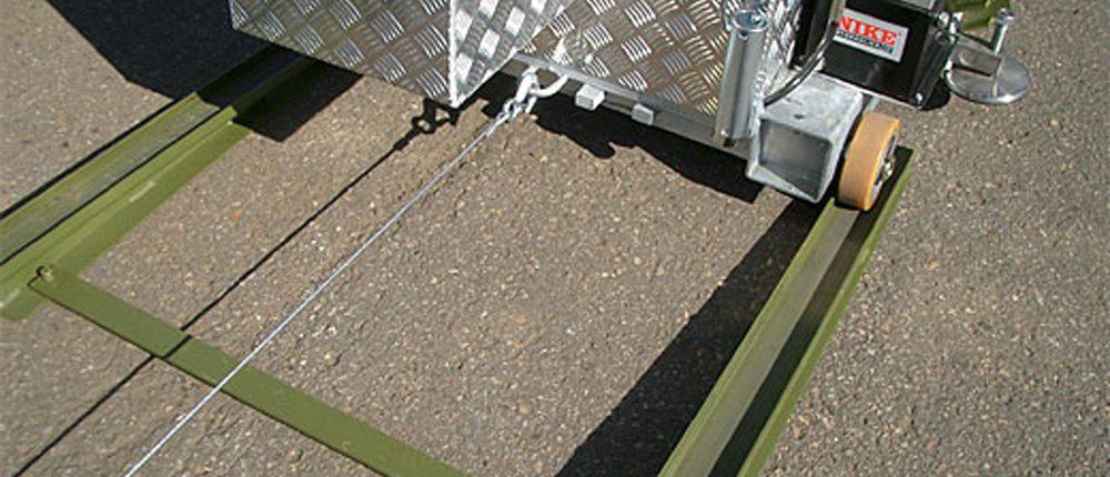Unloading BM20200 mobile roller brake tester from flatrack using electrical winch